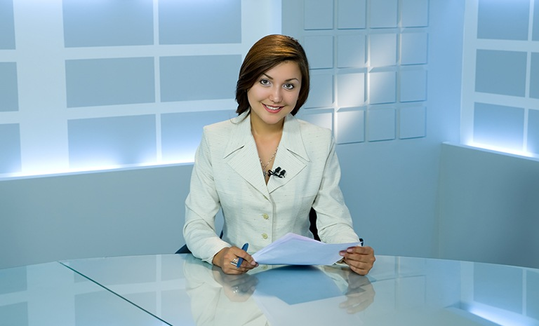 smiling television anchorwoman at studio during work