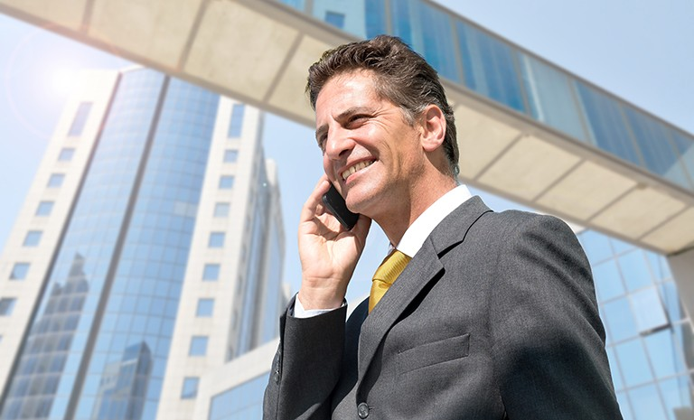 Businessman with cellphone outdoors